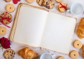 Valentines day background. Blank book with cookies and roses — Stock Photo