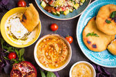 Table served with middle eastern vegetarian dishes. Hummus, tahi — Stock Photo