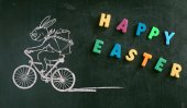 Biking easter bunny drawn with chalk — Stock Photo
