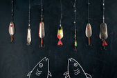 Fishing equipment on black — Stock Photo