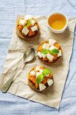 Rye bruschetta with honey pumpkin and goat cheese — Stock Photo