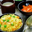 Постер, плакат: Indian vegetarian pilaf Biriyani with carrots and green peas