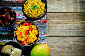 Salad of mango and tomato with red lentils with curry and dates — Stock Photo