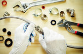Plumber at work with tools plumbing — Stock Photo