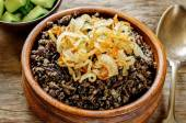 Porridge made with wild rice and black lentils with fried onions — Stock Photo