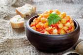 Chickpeas with vegetables and pangasius — Stock Photo