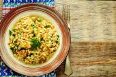 Bulgur with eggplant and greens — Stock Photo
