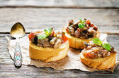 Bruschetta with roasted eggplant and tomatoes — Stock Photo