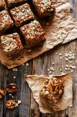 Oatmeal cake with dates and walnuts — Stock Photo