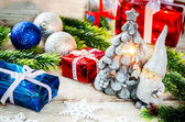 Christmas background with gifts, Santa Claus and balls — Stock Photo
