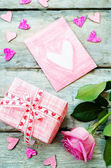 Valentine's background with a gifts, flower and card — Stock Photo