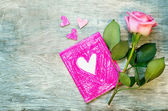 Valentine's background with a flower and card — 图库照片