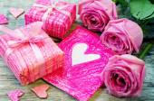 Valentine's background with gifts, flowers and card — Stock Photo
