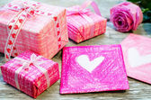 Valentine's background with gifts, flower and card — Stockfoto
