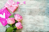 Valentine's background with a gift, flower and card — Stock Photo