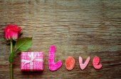 Valentine's background with gift, flower and word Love — Stock Photo