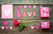 Valentine's background with gift, flower, card and word Love — Stock Photo