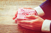 Male hand holding a gift — Stock Photo