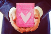 Male hand holding card. Valentine's day. — Foto Stock