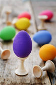 Easter background with colorful eggs on stands — Stock Photo