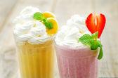 Strawberry and banana milkshake with whipped cream — Stock Photo