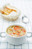 Chicken soup with rice and peppers — Stock Photo