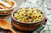 Rice, wild rice, chickpeas with raisins and herbs — Stock Photo