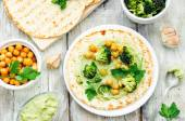 Vegan tortilla with roasted broccoli and chickpeas and avocado s — Stock Photo
