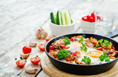 Fried eggs with peppers, tomatoes, quinoa and mushrooms — Stock Photo