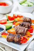 Beef stuffed peppers, carrots and onions with balsamic dressing — Stock Photo