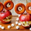 Apples, marshmallows and donuts in the shape of monsters for Hal — Stock Photo #78959198