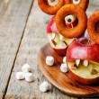 Apples, marshmallows and donuts in the shape of monsters for Hal — Stock Photo #78959226