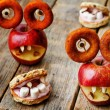 Apples and oatmeal cookies in the shape of monsters for Hallowee — Stock Photo #78959272