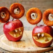 Apples, marshmallows and donuts in the shape of monsters for Hal — Stock Photo #78959284
