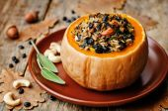 Pumpkin stuffed with rice, black beans, corn, cashews and mushro — Stock Photo