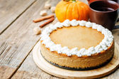 Pumpkin cheesecake decorated with whipped cream — Stock Photo