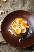 Banana cashew pancakes with bananas and salted caramel sauce — Stock Photo