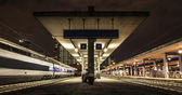 Nocturnal view of a train station — Stock Photo