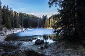Carezza lake in winter with frosty surface  — Stock Photo