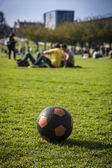 Black and orange ball in a park — Photo