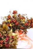 Bouquet of dried withered roses on white background. — Stok fotoğraf