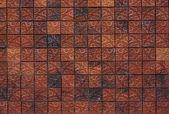 Цветочный узор глина кирпичная стена — Стоковое фото