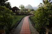 Walkway in resort garden — Stock Photo