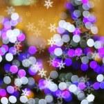 Defocused abstract light bokeh and snow flake on christmas tree — Stock Photo #59293331