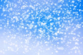 Abstract background of blurred snow storm on blue sky. — Stock Photo