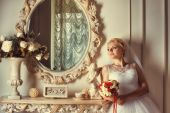 Portrait of blonde bride near the mirror — Foto Stock