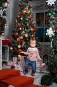 Baby girl standing near the Christmas tree — Foto de Stock