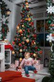 Baby near the Christmas tree — Stock Photo