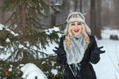 Girl in winter forest — Stock Photo