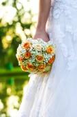 Wedding bridal bouquet of orange roses — Stock Photo